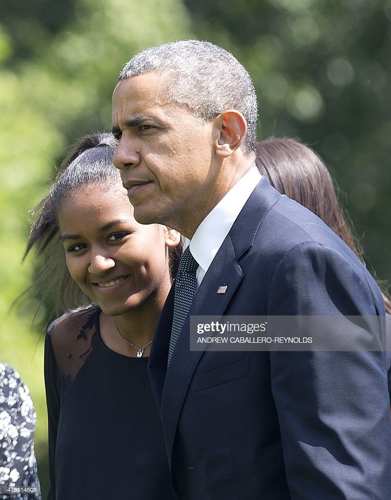 US President Barack Obama speaks with his daughter Sasha after returning to the White House in Washington, DC, on June 6, 2015, after attending the funeral for Vice President Joe Biden's son, Beau Biden. US President Barack Obama will deliver a eulogy at the burial of Vice President Joe Biden's son Beau, who died of cancer aged 46.