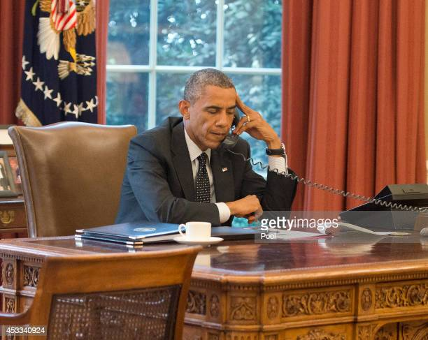 President Barack Obama speaks with King Abdullah II of the Hashemite Kingdom of Jordan on the phone from the Oval Office in the White House on August...