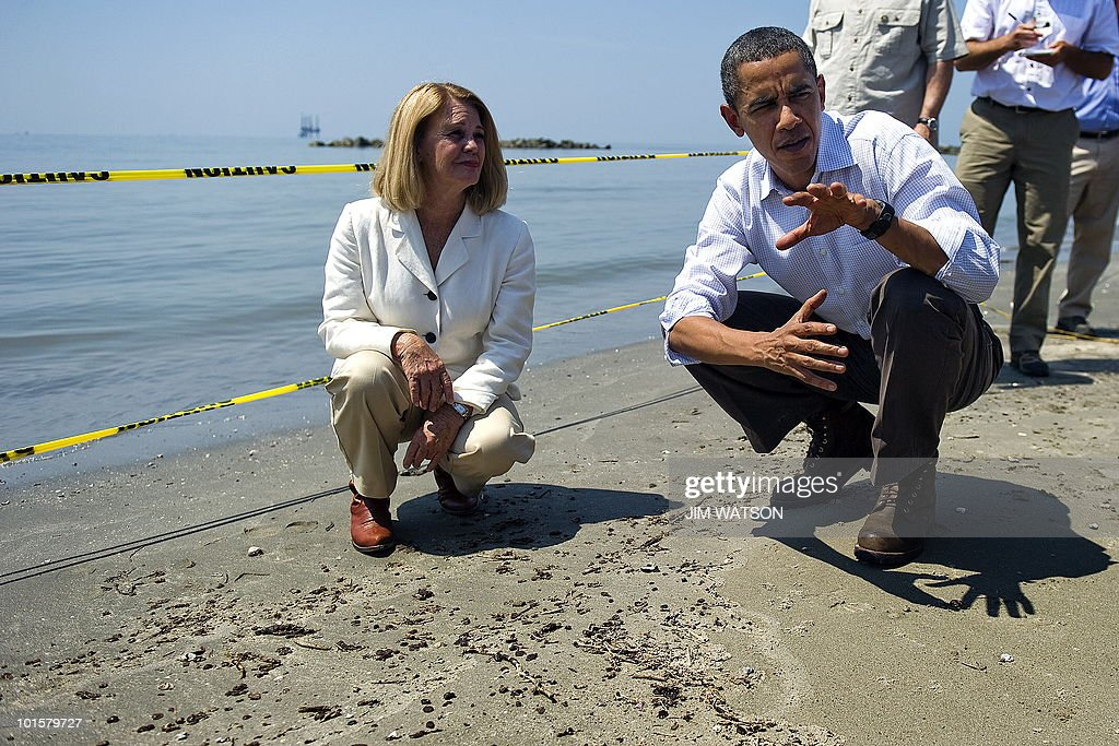 US President Barack Obama (R) speaks with LaFourche Parish President Charlotte Randolph (L) as they look over tar balls at Port Fourchon Beach, Louisiana, on May 28, 2010 before a briefing on the federal government's response to the Gulf Coast oil spill. Obama arrived in Louisiana to view the oil spill response amid suspense over the latest bid to cap the massive leak in the Gulf of Mexico. AFP PHOTO/Jim WATSON