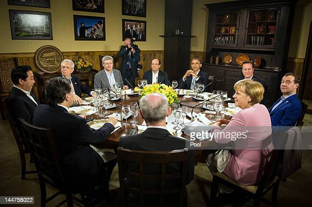 S President Barack Obama speaks with other G8 leaders at Laurel Lodge in Camp David during the 2012 G8 Summit on May 18 2012 in Camp David Maryland...