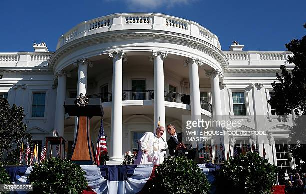 S President Barack Obama speaks with Pope Francis during an arrival ceremony at the White House on September 23 2015 in Washington DC The Pope begins...