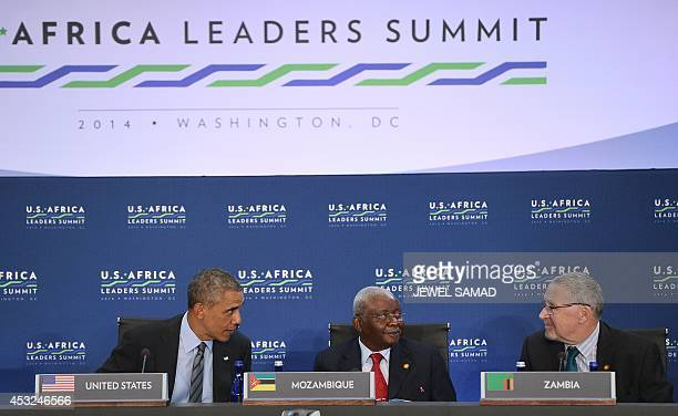 US President Barack Obama speaks with President Armando Emílio Guebuza of Mozambique and Zambia's Vice President Guy Scott during Session 1 Investing...