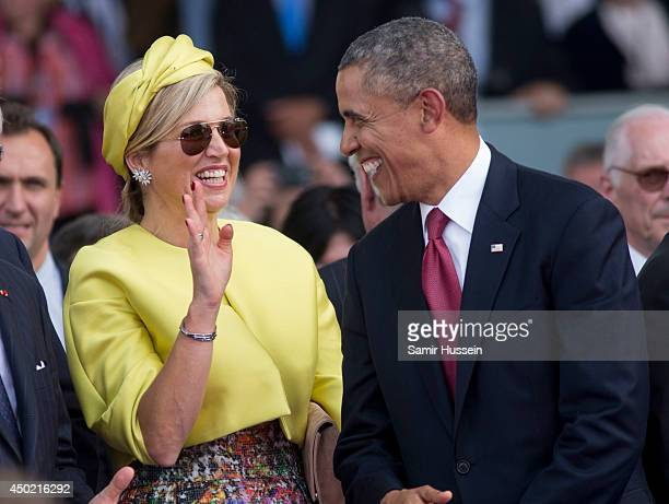 US President Barack Obama speaks with Queen Maxima of Holland as they attend a Ceremony to Commemorate DDay 70 on Sword Beach during DDay 70...