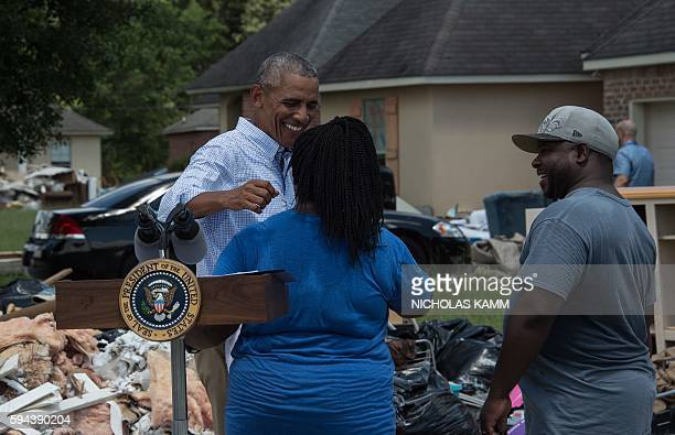 President Barack Obama speaks with residents as he tours a flood-affected area in Baton Rouge, Louisiana, on August 23, 2016. Fresh from a two-week...