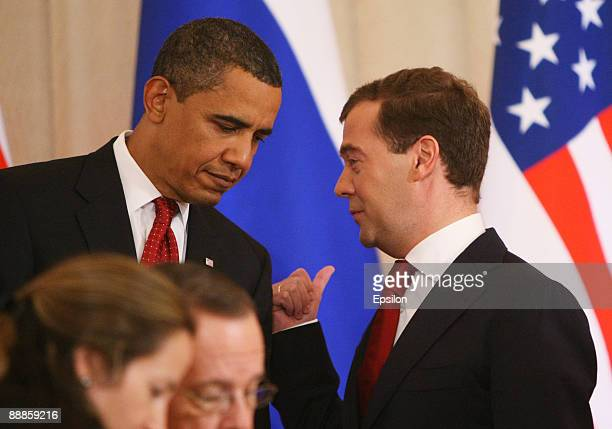 S President Barack Obama speaks with Russian President Dmitry Medvedev as they hold their press conference after the signing ceremony of the Joint...