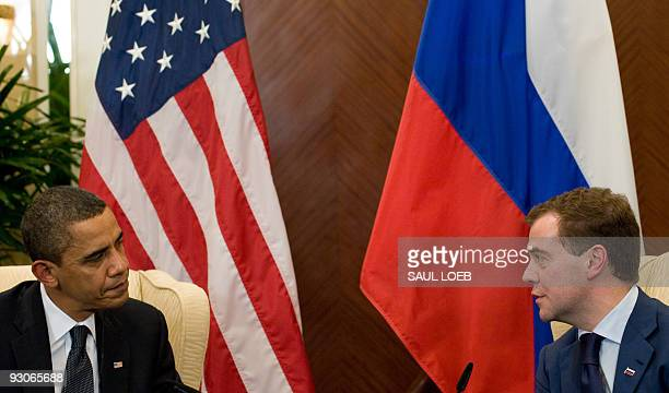 US President Barack Obama speaks with Russian President Dmitry Medvedev during meetings in Singapore site of the AsiaPacific Economic Cooperation...