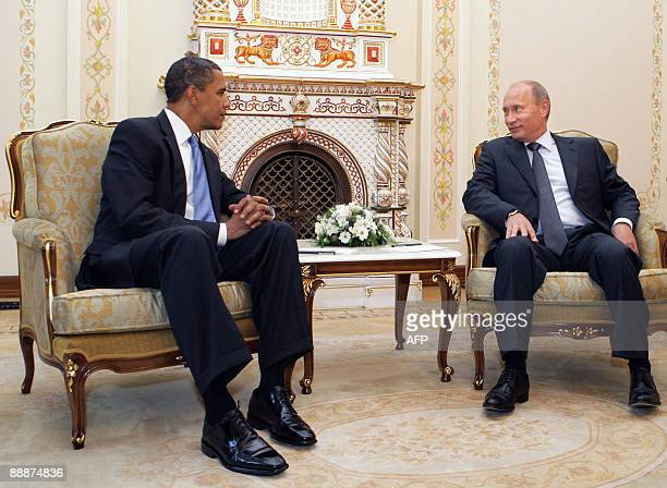 US President Barack Obama speaks with Russian Prime Minister Vladimir Putin outside Moscow in NovoOgarevo on July 7 2009 Putin said Russia was...