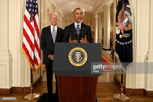 President Barack Obama, standing with Vice President Joe Biden, conducts a press conference in the East Room of the White House in response to the...