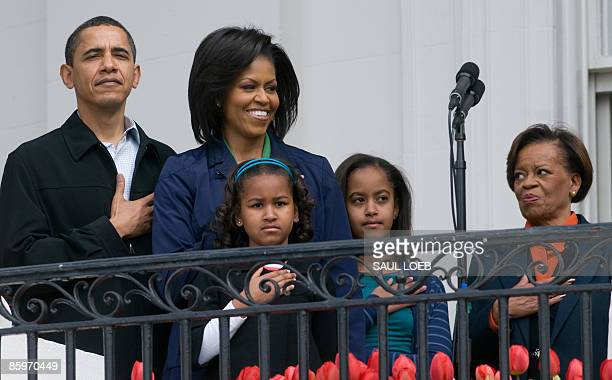 US President Barack Obama stands alongside First Lady Michelle Obama their daughters Sasha and Malia and Marian Robinson Michelle's mother for the...