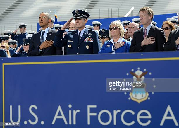 US President Barack Obama stands as the national anthem is played before he delivers commencement address at the US Air Force Academy in Colorado...