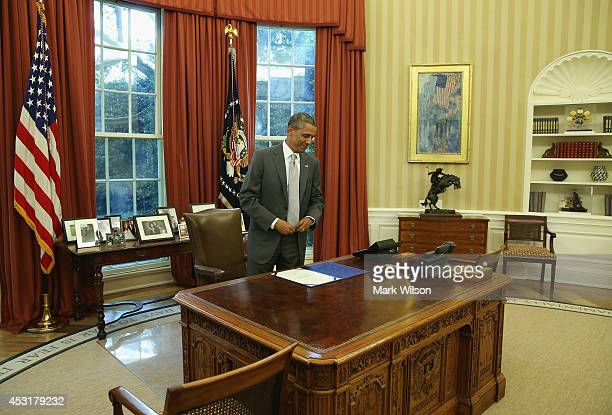 S President Barack Obama stands at his desk after signing the HRRes76 Emergency Supplemental Appropriations Resolution in the Oval Office August 4...