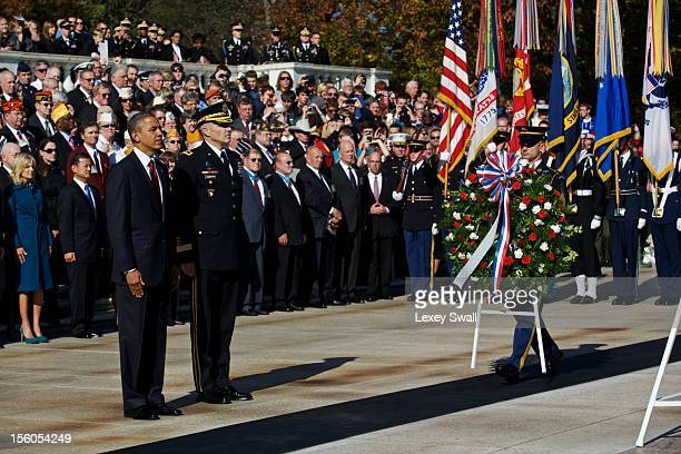 S President Barack Obama stands before the Tomb of the Unknowns with Maj Gen Michael Linnington during the Presidential WreathLaying Ceremony on...