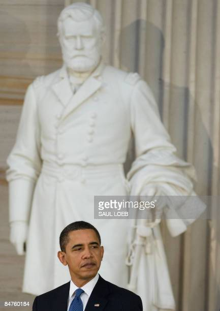 President Barack Obama stands in front of a statue of former US President Ulysses S. Grant during the Lincoln Bicentennial Celebration in the Rotunda...