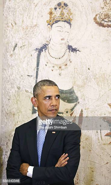 US President Barack Obama stands in front of the reproduced mural of the Horyuji Temple at the Exhibitions about antiterrorism and the conservation...