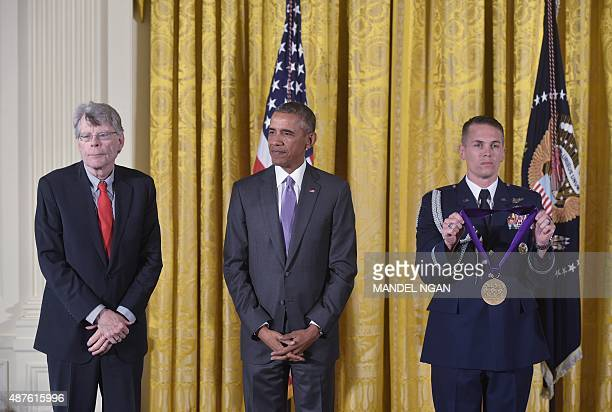 US President Barack Obama stands next to author Stephen King as his citation is read before presenting him with the 2014 National Medal of Arts...