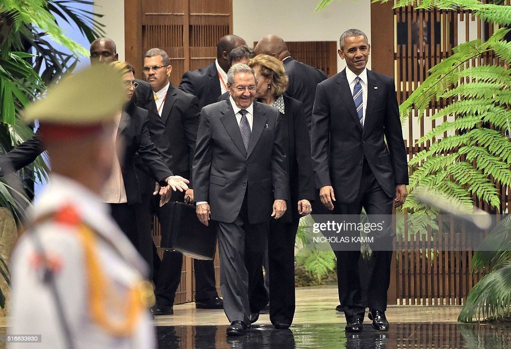 US President Barack Obama (C-R) stands next to Cuban President Raul Castro upon his arrival at the Revolution Palace in Havana on March 21, 2016. US President Barack Obama and his Cuban counterpart Raul Castro met Monday in Havana's Palace of the Revolution for groundbreaking talks on ending the standoff between the two neighbors.