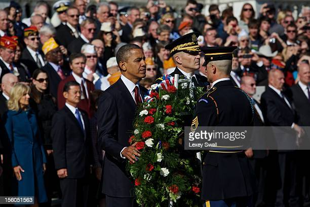 S President Barack Obama stands next to Major General Michael S Linnington as he prepares to lay the wreath in front of the Tomb of the Unknowns...