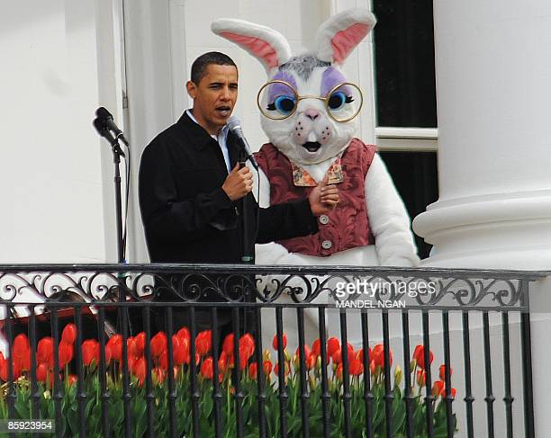 US President Barack Obama stands next to the Easter Bunny as addresses a crowd from the balcony of the White House during the annual Easter Egg Roll...