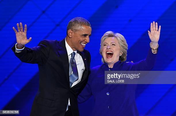 President Barack Obama stands on stage with Democratic presidential nominee Hillary Clinton on Day 3 of the Democratic National Convention at the...