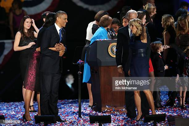 S President Barack Obama stands on stage with first lady Michelle Obama US Vice President Joe Biden and Dr Jill Biden after his victory speech on...