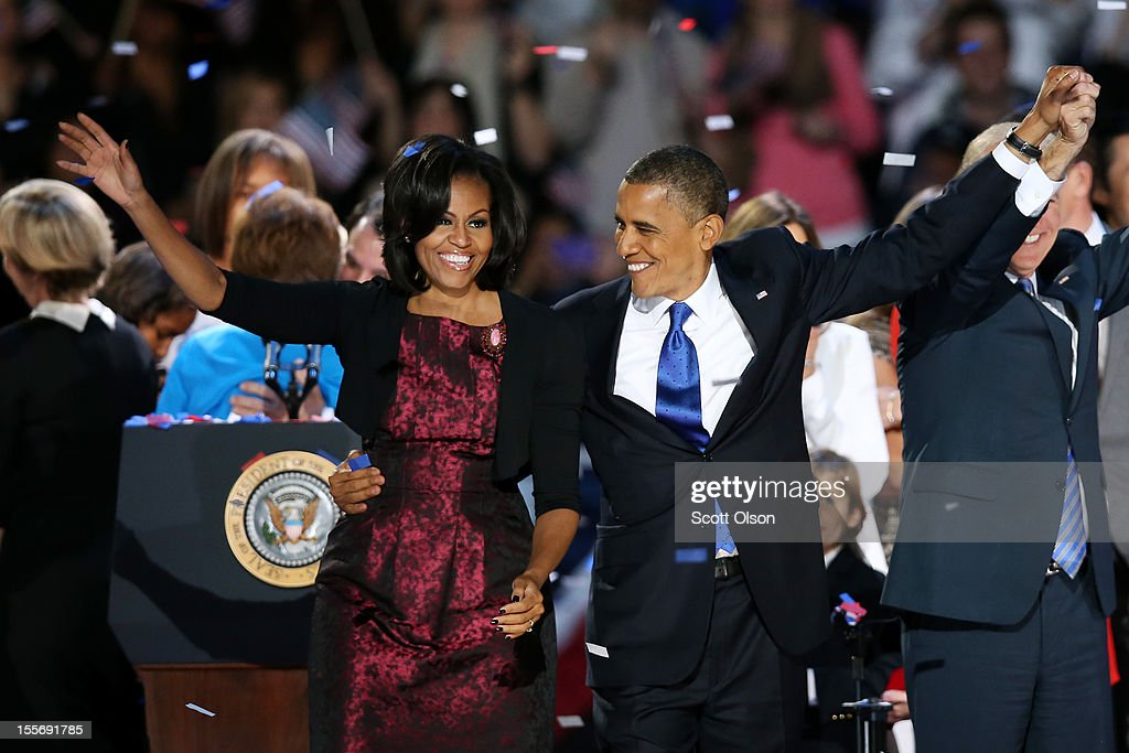 U.S. President Barack Obama stands on stage with first lady Michelle Obama after his victory speech on election night at McCormick Place November 6, 2012 in Chicago, Illinois. Obama won reelection against Republican candidate, former Massachusetts Governor Mitt Romney.