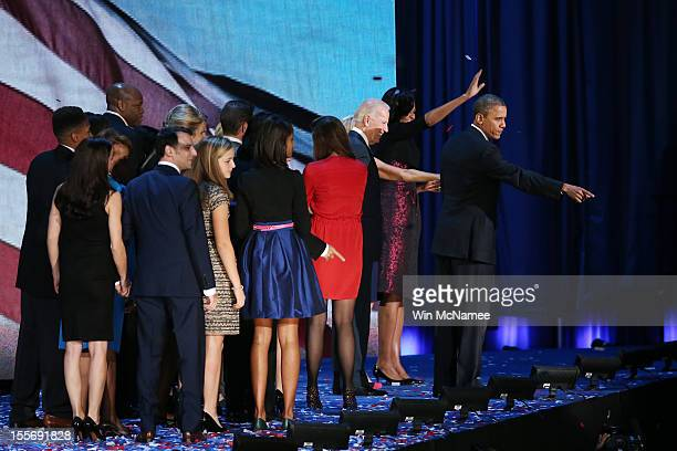 S President Barack Obama stands on stage with Vice President Joe Biden first lady Michelle Obama daughters Sasha and Malia and friends after his...