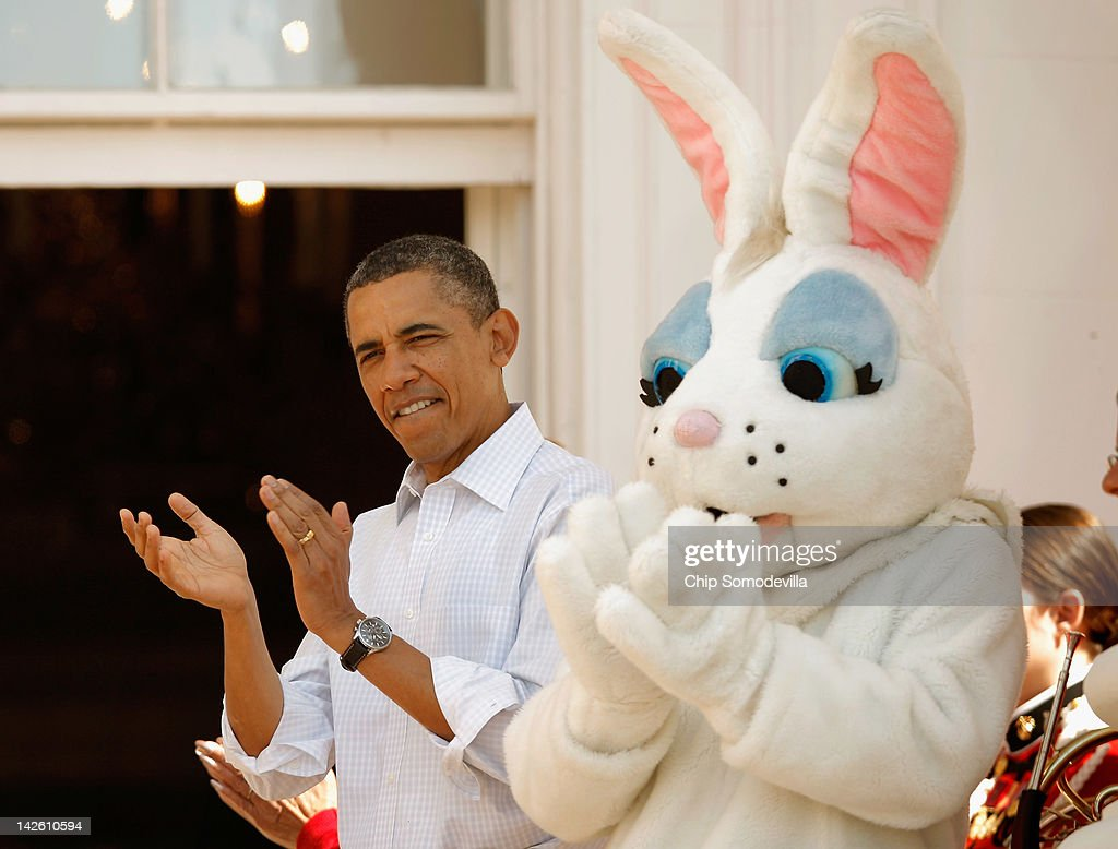 U.S. President Barack Obama stands with a person in an Easter rabbit costume during the annual Easter Egg Roll on the South Lawn of the White House April 9, 2012 in Washington, DC. Thousands of people are expected to attend the 134-year-old tradition of rolling colored eggs down the White House lawn that was started by President Rutherford B. Hayes in 1878.