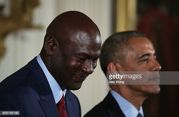 S President Barack Obama stands with former NBA player Michael Jordan during the Presidential Medal of Freedom presentation ceremony at the East Room...
