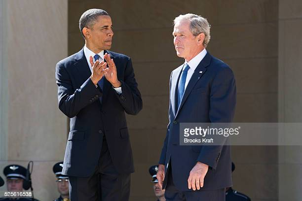 President Barack Obama stands with former presidents, from second from left, George W. Bush, Bill Clinton, George H.W. Bush, and Jimmy Carter at the...