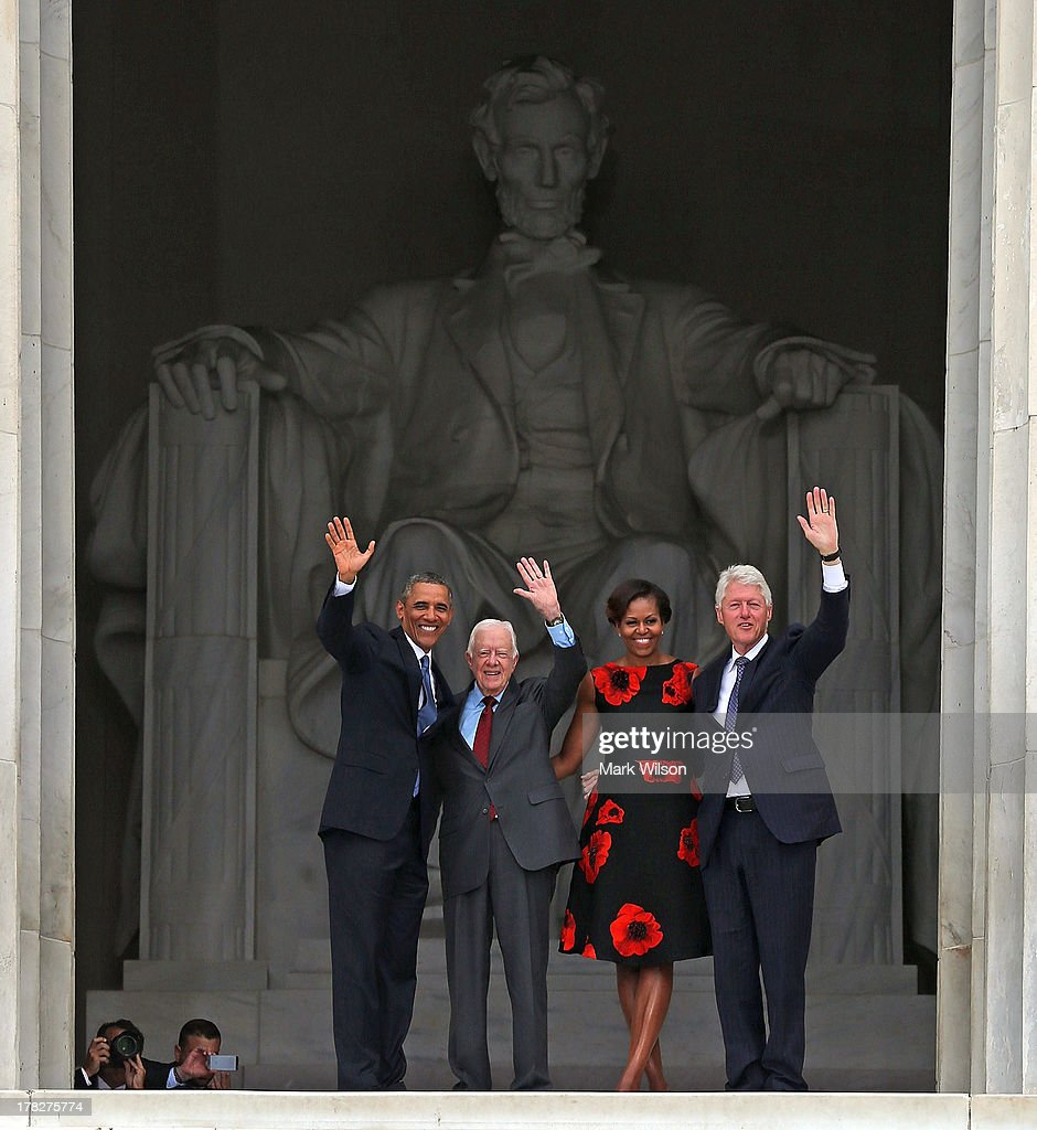 President Barack Obama (L) stands with his wife Michelle Obama (2nd-R) former presidents Jimmy Carter (2nd-L) and Bill Clinton during the ceremony to commemorate the 50th anniversary of the March on Washington for Jobs and Freedom August 28, 2013 in Washington, DC. It was 50 years ago today that Martin Luther King, Jr. delivered his 'I Have A Dream Speech' on the steps of the Lincoln Memorial.