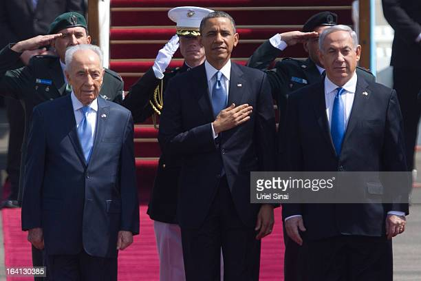 US President Barack Obama stands with Israeli President Shimon Peres and Israeli Prime Minister Benjamin Netanyahu for the American national anthem...
