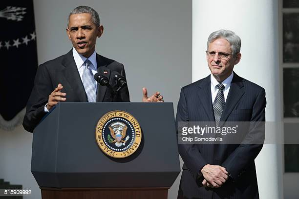 President Barack Obama stands with Judge Merrick B. Garland, while nominating him to the US Supreme Court, in the Rose Garden at the White House,...