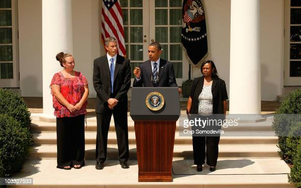 S President Barack Obama stands with laidoff teachers Shannon Lewis and Rachel Martin and Education Secretary Arne Duncan while making a statement...