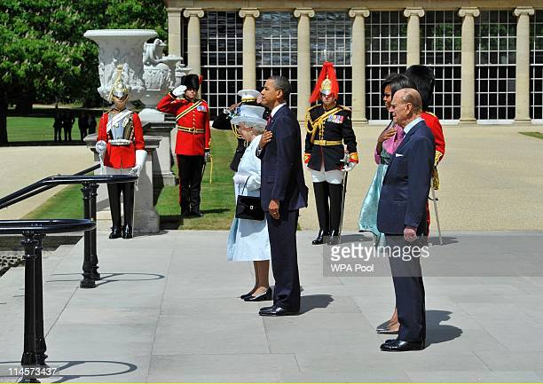 President Barack Obama stands with Queen Elizabeth II as First Lady Michelle Obama stands with Prince Philip Duke of Edinburgh during the US National...