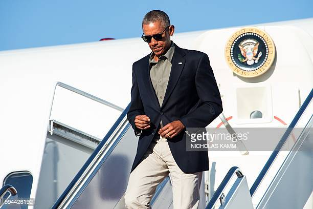 President Barack Obama steps off Air Force One at Andrews Air Force Base in Maryland after touring a flood-affected area in Baton Rouge, Louisiana,...