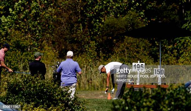 US President Barack Obama stretches before playing golf at Renditions Golf Club in Davidsonville Md on September19 2015 Photo by WHITE HOUSE POOL...