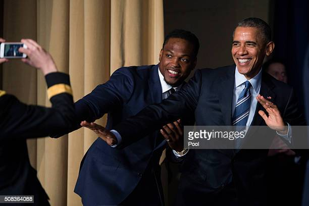 S President Barack Obama strikes the Heisman pose with Heisman Trophy winner Derrick Henry at the conclusion of the National Prayer Breakfast on...