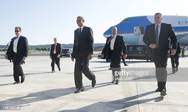 US President Barack Obama surrounded by Secret Service agents walks to greet wellwishers upon arrival on Air Force One at Boeing Field in Seattle...