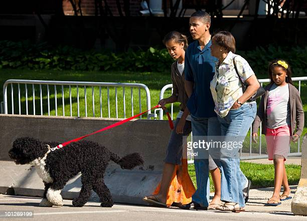 President Barack Obama takes a walk down the street from his home accompanied by his motherinlaw Marian Robinson daughters Malia Obama and Sasha...