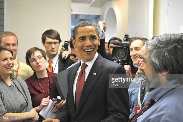 President Barack Obama takes an impromptu tour of the White House press work area January 22, 2009 in Washington, DC. The president made the surprise...