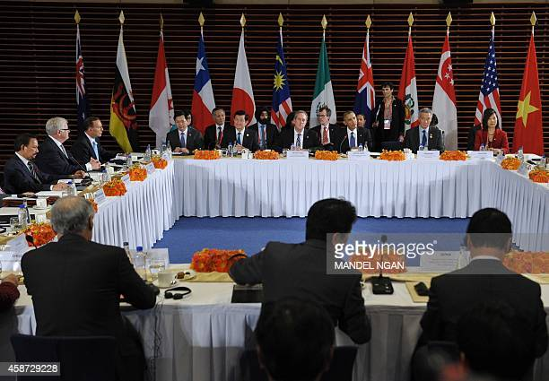 US President Barack Obama takes part in a meeting with leaders from the TransPacific Partnership at the US Embassy in Beijing on November 10 2014 in...