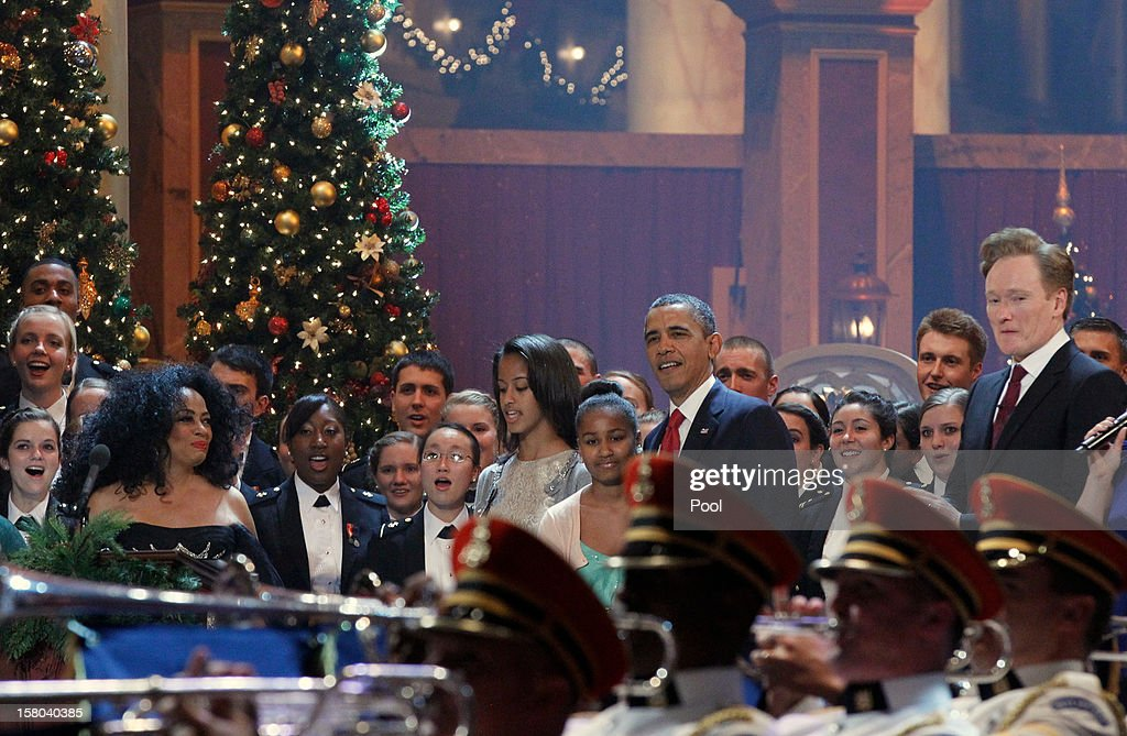 U.S. President Barack Obama (Center R) takes part in the 'Christmas in Washington' concert with daughters Malia (Center L) and Sasha Obama (C), as host Conan O'Brien (R) and Performer Diana Ross (L) look on at the National Building Museum on December 9, 2012 in Washington, D.C. The concert benefits the National Childrens Medical Center and is hosted by comedian Conan O'Brien.