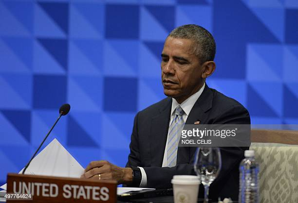 """President Barack Obama takes part in the leaders' """"Retreat 1"""" at the annual 21-member Asia-Pacific Economic Cooperation summit in Manila on November..."""