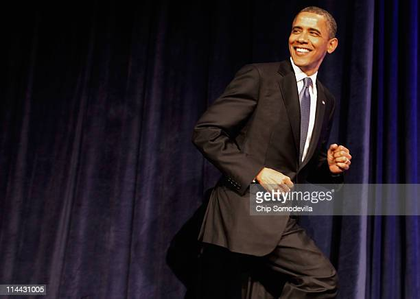 US President Barack Obama takes the stage before addressing the Women's Leadership Forum at the Grand Hyatt Hotel May 19 2011 in Washington DC Obama...