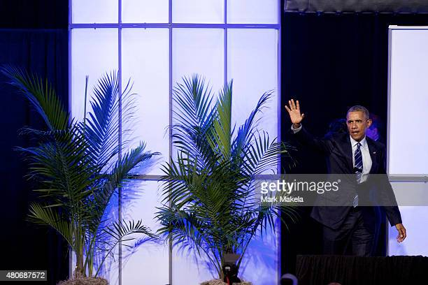 S President Barack Obama takes the stage to address attendees at the 106th NAACP national convention on July 14 2015 in Philadephia Pennsylvania...