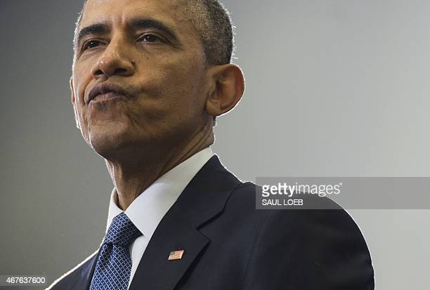 US President Barack Obama talks about his NCAA Men's College Basketball March Madness tournament bracket picks before speaking about the financial...