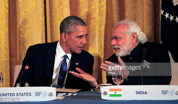 President Barack Obama talks to Prime Minister Narendra Modi of India a working dinner with heads of delegations at the Nuclear Security Summit March...