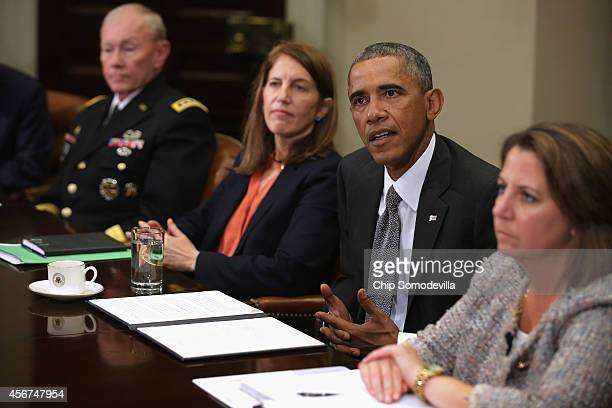 S President Barack Obama talks to reporters after a meeting on the Ebola outbreak in West Africa with Chairman of the Joint Chiefs of Staff Gen...