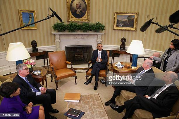 S President Barack Obama talks to reporters with Commerce Secretary Penny Pritzker former IBM CEO Sam Palmisano former White House National Security...