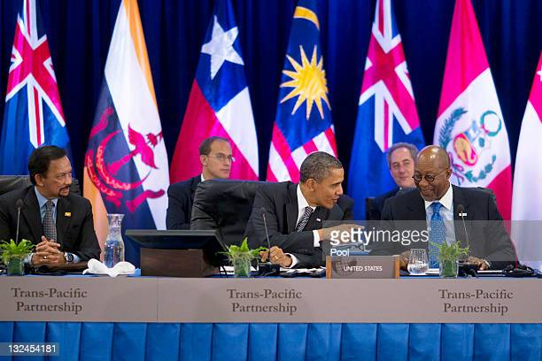 US President Barack Obama talks to US Trade Representative Ron Kirk as he meets with TransPacific Partnership leaders during the APEC CEO Summit at...
